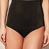 Wear a pair of high-waisted bikini bottoms ($42) under your sheer dress.