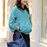 Leighton Meester wore a blue cap on the set of Gossip Girl.