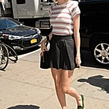 Green loafers offered a surprising contrast to Taylor's black-and-red ensemble.