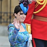 For the 2011 wedding of Prince William and Kate Middleton, Princess Eugenie wore a daring blue accessory topped with feathers and flowers.