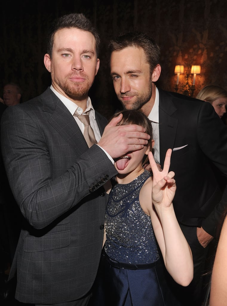 White House Down star Channing Tatum and producer Reid Carolin kept Channing's young co-star Joey King shielded from the antics at the film's premiere in New York on June 25.