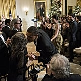President Obama kissed Toby Perlman during the reception.