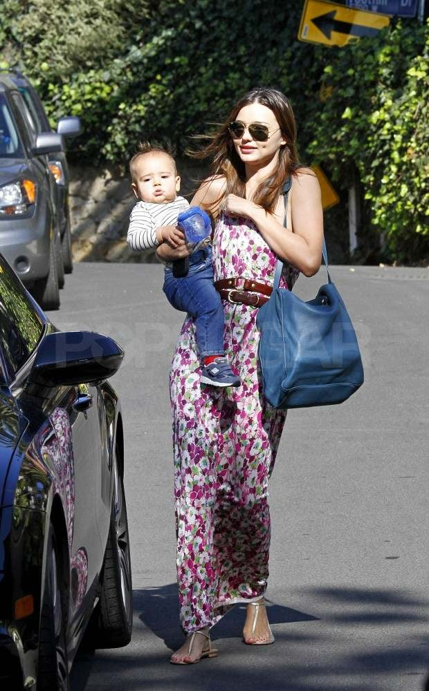 Miranda Kerr and Flynn met up with some friends in LA yesterday afternoon. Miranda wore a bright floral maxi dress while Flynn showed off his toddler style in jeans and a striped shirt. The little guy recently turned one and according to Miranda he celebrated by eating cake for the first time. Miranda chatted about her son's milestone birthday on the red carpet at last week's Spirit of Australia Party for Qantas Airways, where she also told us he looks like dad Orlando Bloom but has her personality. Miranda continued her red carpet run with Orlando by her side at InStyle's Golden Globes afterparty on Sunday.