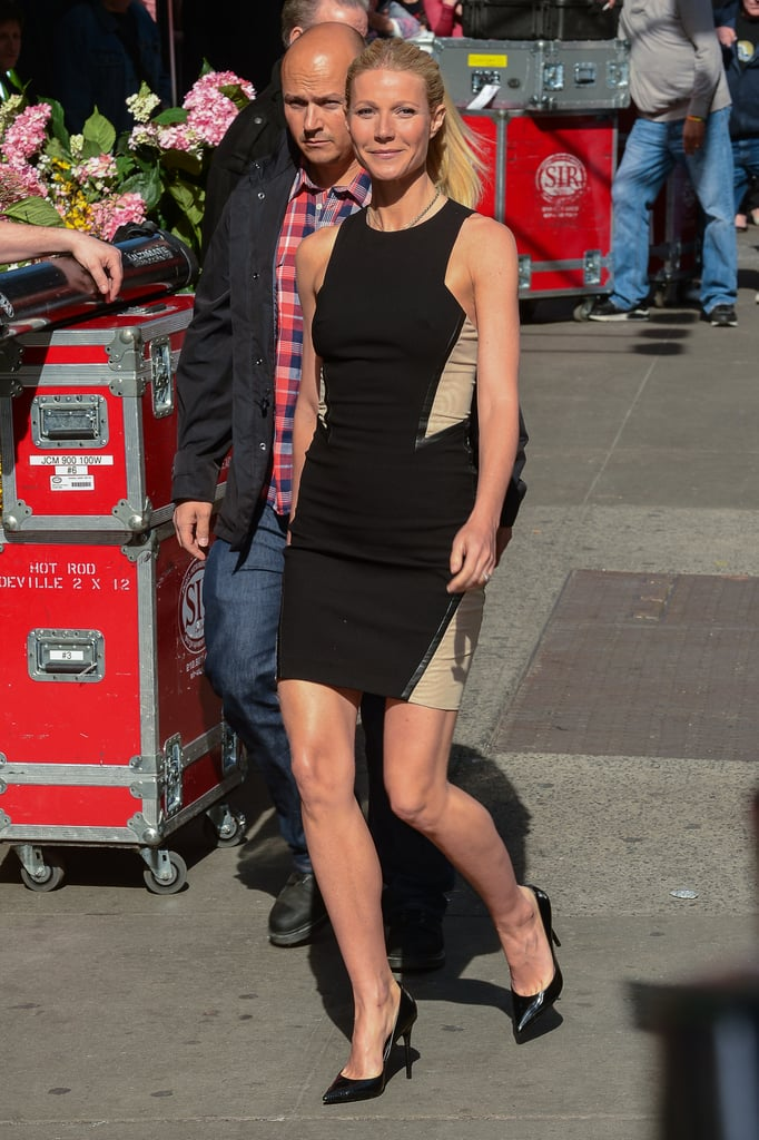 Gwyneth Paltrow showed off her figure in a tight black dress leaving Good Morning America.