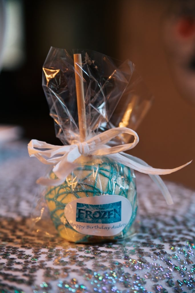 These candied apples were decorated with white and blue chocolate, making them tasty and perfect for the party's theme.