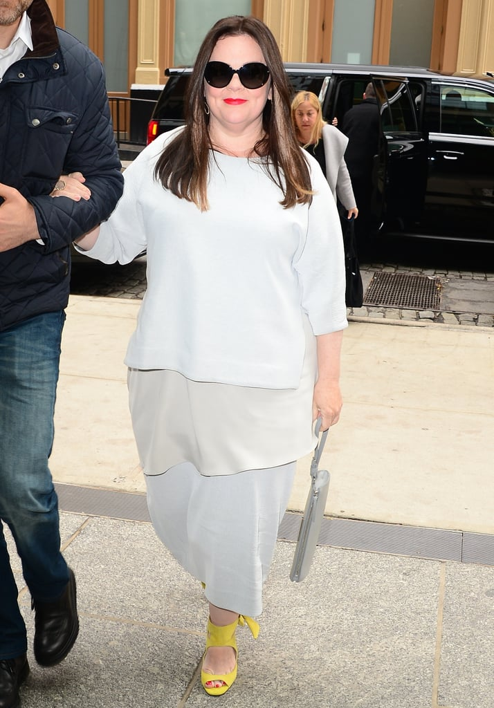 Melissa McCarthy Wearing Gray Outfit and Yellow Shoes