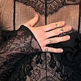Miley's right hand has nine tiny tattoos, total. Starting on the tops of her fingers, she has a heart (which matches her mom's!), an alien head, a watermelon, and an evil eye.