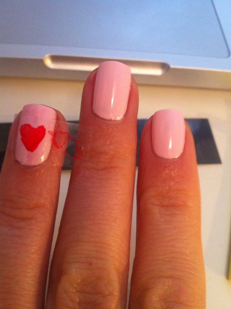 Here's the big love heart. You just stick the sticker firmly onto your nail and apply the pen into the shape. You have to be very gentle because the pen releases colour quickly.