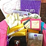 "Bonjour Jolie  The Bonjour Jolie monthly subscription box comes with a lot of goodies for the price and offers all commercially available feminine product brands sold in the US. There's also a box tailored toward young teens. How it works: You set your preferences, submit your cycle information, share any special requests, and then choose 30 pads, tampons, and/or liners (any brand, any size, any combination). For $16 (plus shipping) you receive the 30 period products, bath and body items, gifts, teas, and chocolates. June's theme is ""Summer of Color"" and contains a full-size lip-stain marker, four-piece chocolate truffle set, five organic tea bags, rose soap petals, and samples (shampoo/conditioner set, Kiehl's lotion, cleansing cloths, and Advil)."