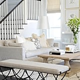 In the living area Troy and I wanted a look that was livable, inviting and having a very clean simple yet elegant look to it. We chose two linen sofas facing one another, with a very heavy restored wood coffee table in-between.