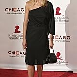 Working a one-shoulder bell-sleeved LBD, Aniston stepped out to show her support for St. Jude's Children Hospital in August 2003.