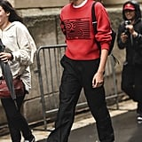 Kaia Gerber Was Spotted Leaving the Proenza Schouler Show in a Red Sweatshirt From the Brand
