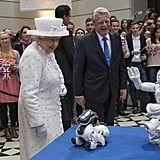 Queen Elizabeth II and German President Joachim Gauck watch robots at Berlin's University of Technology in 2015.