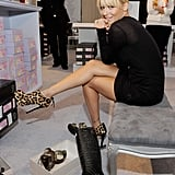 Nicole Richie tries on shoes at the Shoes on Sale charity event.