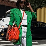 If you're about to reach for your black blazer, stop. Slip on a more colorful option, like this green one, which will instantly give your white tee and jeans combo new life.