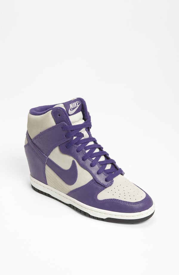 "Channel old-school court style with these Nike ""Dunk Sky Hi"" Wedge Sneakers ($120)."