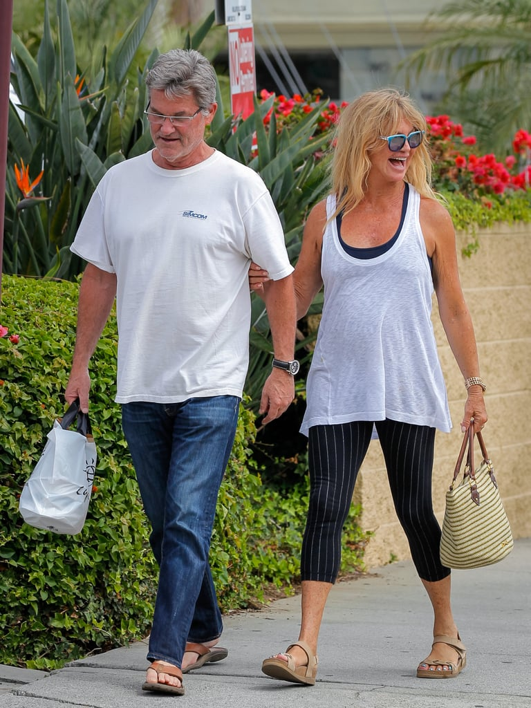 """Kurt Russell and Goldie Hawn were spotted out and about on a smiley stroll in LA on Thursday. They linked arms and stayed close while walking side by side, and gave a wave to a passerby. It's been a while since we've seen the couple in public, though they have made separate outings over the Summer; Kurt popped up at Comic-Con to support the upcoming Quentin Tarantino film The Hateful Eight, and Goldie stepped out with her daughter, Kate Hudson, for the Glamour Women of the Year Awards. She also joined Kate on a fun girls' getaway to Greece in June and showed off her impressive beach body in a sleek one-piece swimsuit.  The couple, who have been dating since 1983 and have starred together in three films, proved that they were the definition of #RelationshipGoals recently when they cuddled for a movie night together. Goldie tweeted out about the date night, saying, """"Kurt n I snuggled up and watched Overboard together. The first time we have seen it all the way thru since it came out. Now that's Romance."""" Keep reading to see their latest cute pictures, and check out more Hollywood pairs whose relationships have stood the test of time."""
