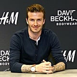 David Beckham showed off his tattoos.