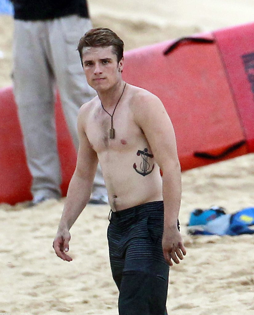Josh Hutcherson wore a necklace and board shorts.