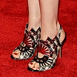January Jones was all about the punk theme at this year's Met Gala, wearing safety-pin-accented sandals.