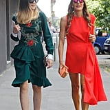 Anna Dello Russo matched her mirrored shades to her poppy-hued minidress.
