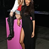 Cara Delevingne and Jourdan Dunn exuded two totally different vibes while sitting front row at the Rihanna For River Island show. Cara was funky in denim cutoffs and over-the-knee lace-up boots, while Jourdan looked subtly sexy in a black maxi dress with a thigh-high slit and pink studded Christian Louboutin pumps.