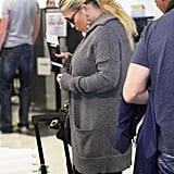 Jessica Simpson adjusted her cozy, gray sweater.