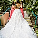 This bride had two beautiful bridesmaids by her side in coral floor-length gowns.