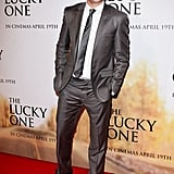 Zac Efron wore a gray suit to the event.