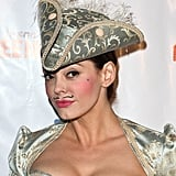 """Rose McGowan rocks a mustache at the LA Gay & Lesbian Center's annual """"Halloweenie"""" party."""