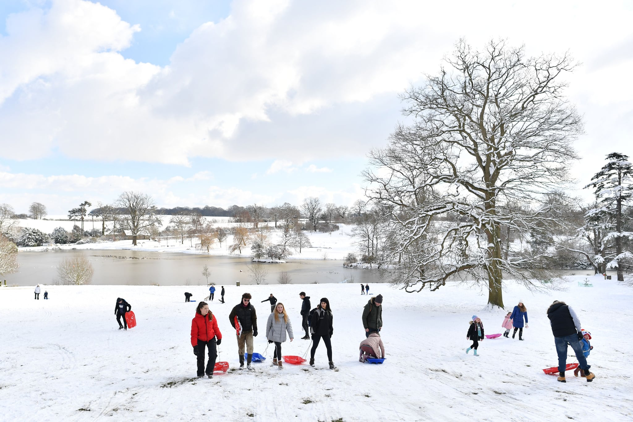 People go sledging in Dunorlan park in Tunbridge Wells following a heavy snowfall on February 27, 2018.A blast of Siberian weather sent temperatures plunging across much of Europe on Tuesday, causing headaches for travellers and leading to several deaths from exposure as snow carpeted palm-lined Mediterranean beaches. / AFP PHOTO / Ben STANSALL        (Photo credit should read BEN STANSALL/AFP/Getty Images)