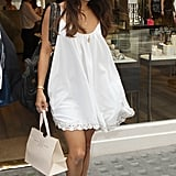 Vanessa Hudgens did a little shopping in London wearing a white tank dress by Lovers + Friends and black add-ons: a turban headband and black pumps.