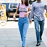 Pairing a graphic tee and jeans with one of the biggest bag trends of the season makes Kendall's look a home run.