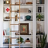The sliding library ladder gives the built-ins an undeniably high-end look.
