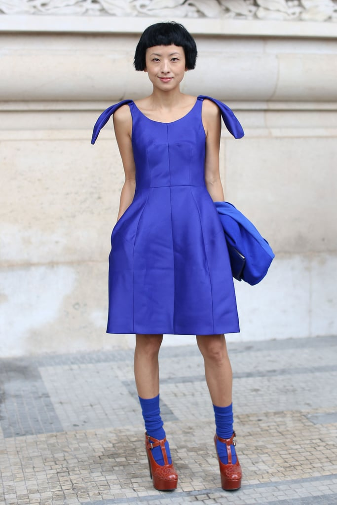 Such a pretty shade of blue, why wouldn't you want your socks to match? Her cheeky socks complement the vibrant hue of her dress and lend a charming, unique touch.
