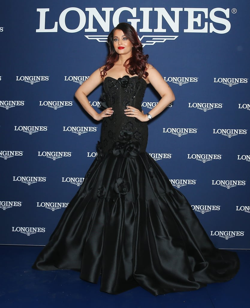 Wearing a strapless black gown with an embellished bodice.