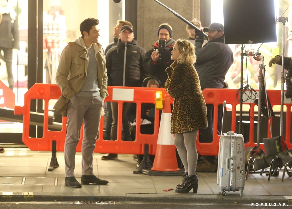 Emilia Clarke and Henry Golding are ready for a Christmas romance! Just three months after it was announced that Clarke and Golding had signed on to star in director Paul Feig's new project, Last Christmas, production has officially begun. On Dec. 12, Golding and Clarke were spotted braving the cold as they shot scenes for the rom-com on London's famous Regent Street. In the first-look photos, the actors are seen chatting in the major shopping district, and at one point, Clarke hops inside a red double-decker bus. What does all this mean?! While details about the film are still pretty scarce, the fact that it takes place in London around Christmas is giving us major Love Actually vibes. Not to mention, Emma Thompson — who played Karen in Love Actually — is one of the screenwriters attached to the film. Feig's previous work includes Bridesmaids, The Heat, Ghostbusters, and Golding's recent A Simple Favor, so we already know it's going to be good.       Related:                                                                                                           Jingle All the Way to the Holidays With Netflix's Crazy-Good 2019 Christmas Movie Selection