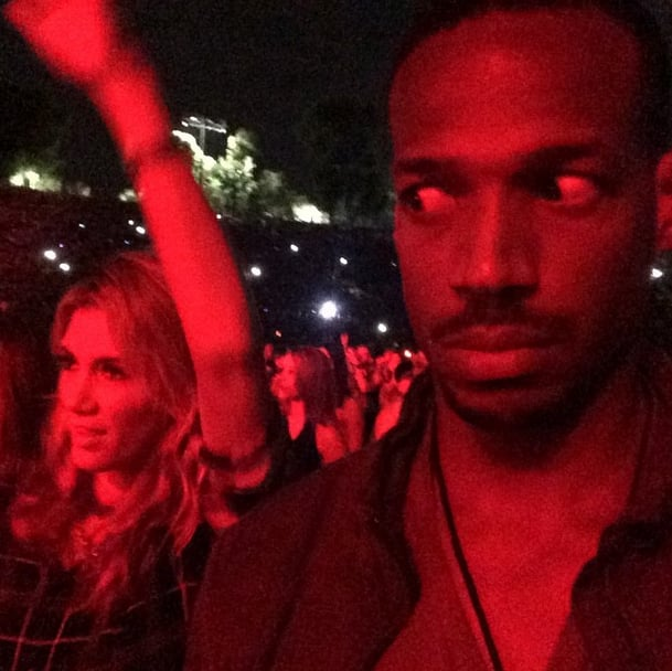 "On Sunday, Marlon Wayans captioned this pictures: ""Man I got the most UNRHYTHMIC WHITE WOMAN dancing next to me at the jay and bay concert . . . This b*tch dancing to AC/DC."" The woman in question was Australian singer Delta Goodrem.  Source: Instagram user marlonwayans"