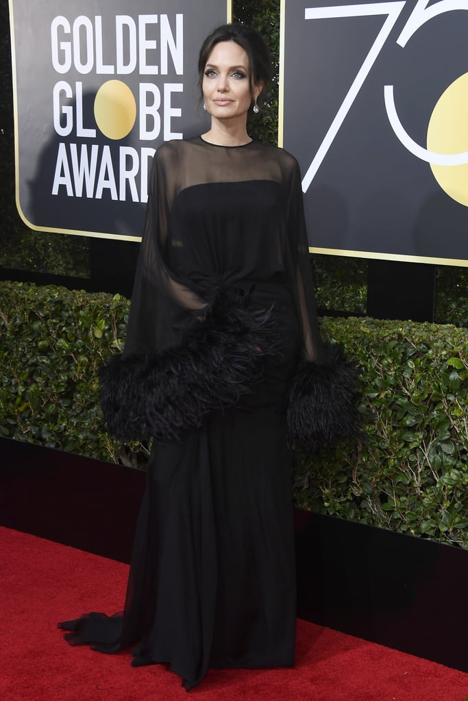 At the 2018 Golden Globe Awards wearing Atelier Versace.
