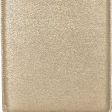 This shimmery gold case is equal parts modern and glamorous.  Jimmy Choo Tyler Metallic Textured-Leather iPad Sleeve ($495)