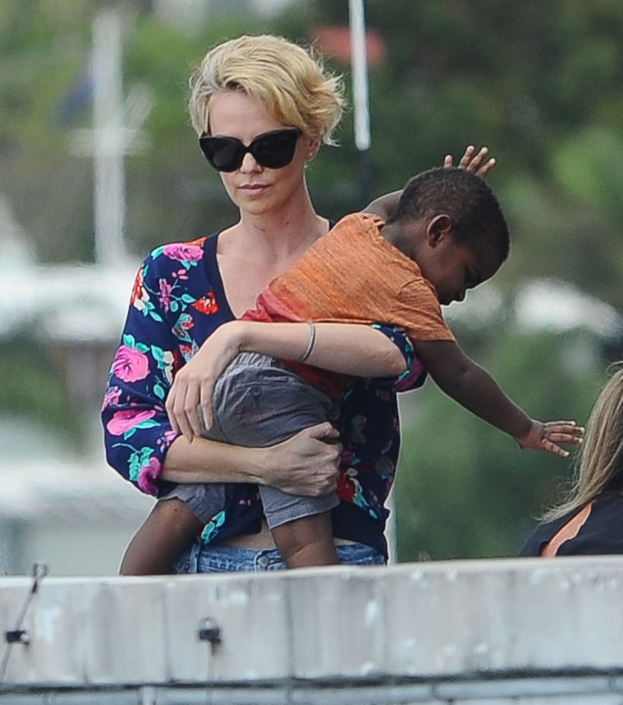 Charlize Theron carried her squirmy little boy on Sunday in Sydney, Australia.