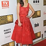 Zooey Deschanel channeled her signature retro-feeling charm in a sweet, red floral appliqué Oscar de la Renta gown. She perfected the ladylike style with classic black pumps.