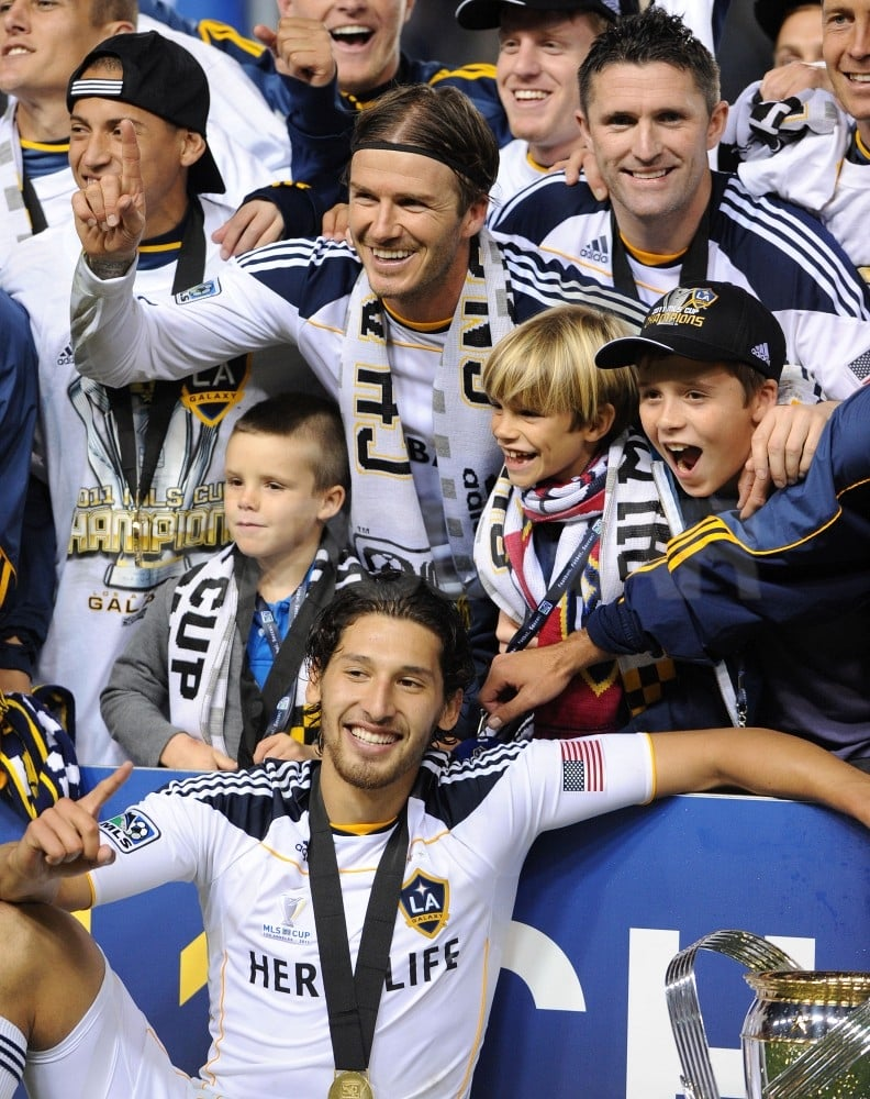 David Beckham put up the number one sign while his sons, Cruz, Romeo, and Brooklyn, cheered on.