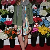 Analeigh Tipton made a splash on the red carpet in a watercolor shirtdress, army anorak, and strappy black sandals at the Prabal Gurung For Target launch party.