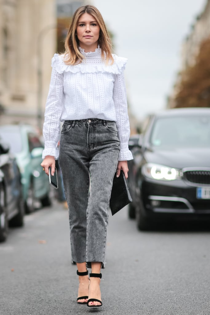 With a girlie blouse and chic heels