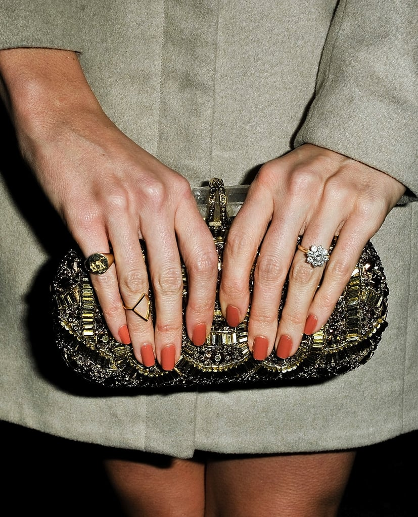 The rich gold detailing on this structured clutch would add sparkle to any look.