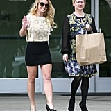 Britney Spears walked with a friend out of the church.
