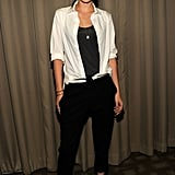 At the September 2012 NYC screening of On the Road, Stewart struck a pose in an open white Balenciaga button-down blouse, revealing a satin charcoal tank, contrast-waist A.L.C. trousers, and strappy Jimmy Choo sandals.