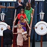 Dave Clark, Prince Harry, Prince William, Kate Middleton, Princess Eugenie, and Princess Beatrice leave a wedding drinks with their aunt Sophie.