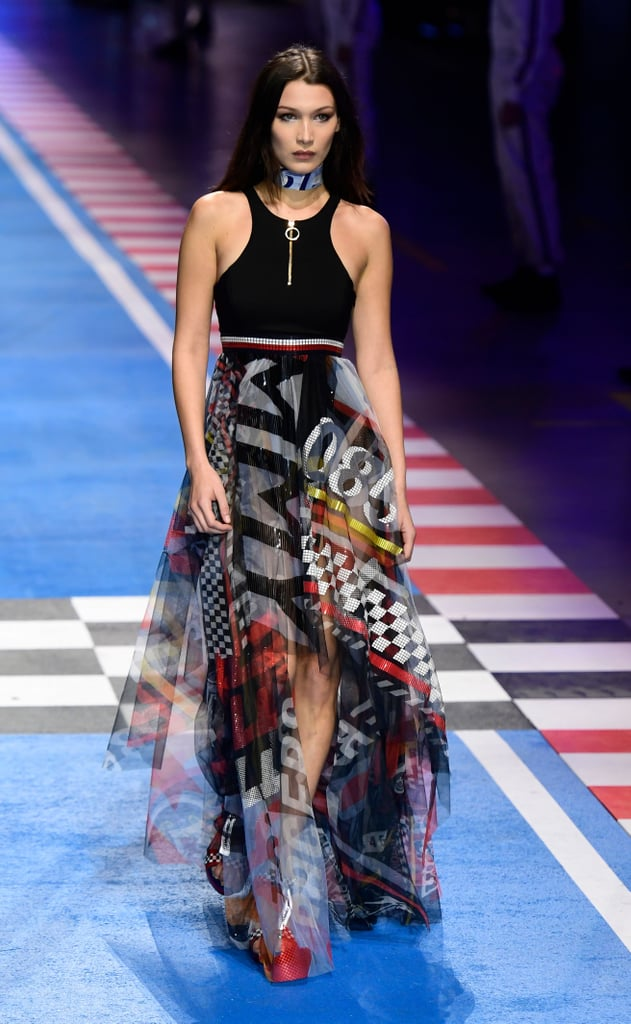 7a3629df5ad81e Wearing a racer-inspired dress during the Tommy Hilfiger x Gigi Hadid show  in Milan